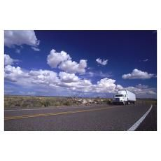 white tractor trailer drives down highway #285, nm Poster