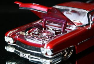 1959 Cadillac Coupe DeVille Dub City Diecast 1 24 M Red
