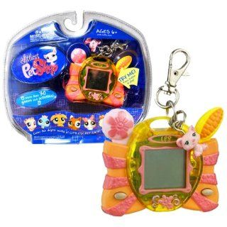 """Hasbro Year 2007 Littlest Pet Shop Digital Pets """"Care For Me"""" Series Virtual Game   Pink PIG Digital Game with Charms , Clip for On the Go Fun and 30 Games and Activities Toys & Games"""