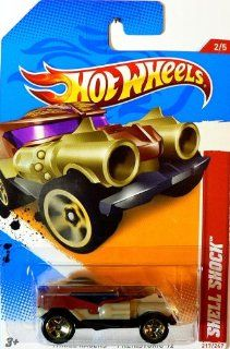2012 Hot Wheels Thrill Racers   Prehistoric #2/5 Brown & Gold SHELL SHOCK Collectible 1:64 Scale Car 217/247: Toys & Games