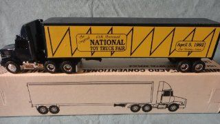 ERTL 1:64 SCALE 1992 WHITE GMC AERO CONVENTIONAL SEMI WITH TRAILER NATIONAL TOY TRUCK FAIR DIE CAST, DES MOINES IOWA 1992 TOY FAIR TRUCK DIE CAST: Toys & Games